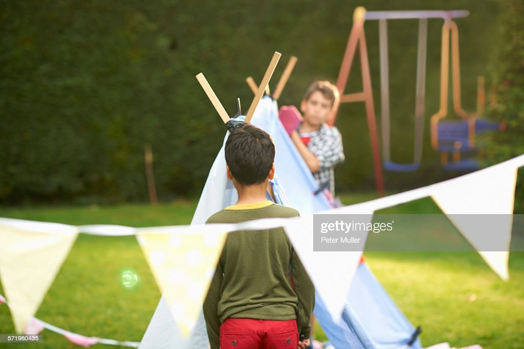 Two brothers preparing homemade tent in garden  Stock Photo & Two Brothers Preparing Homemade Tent In Garden Stock Photo | Getty ...