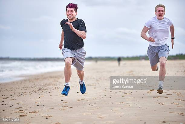 Two brothers racing on the beach