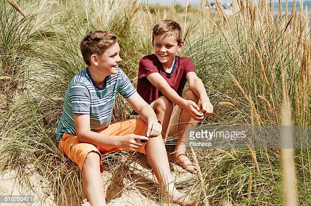 Two brothers relaxing at the beach