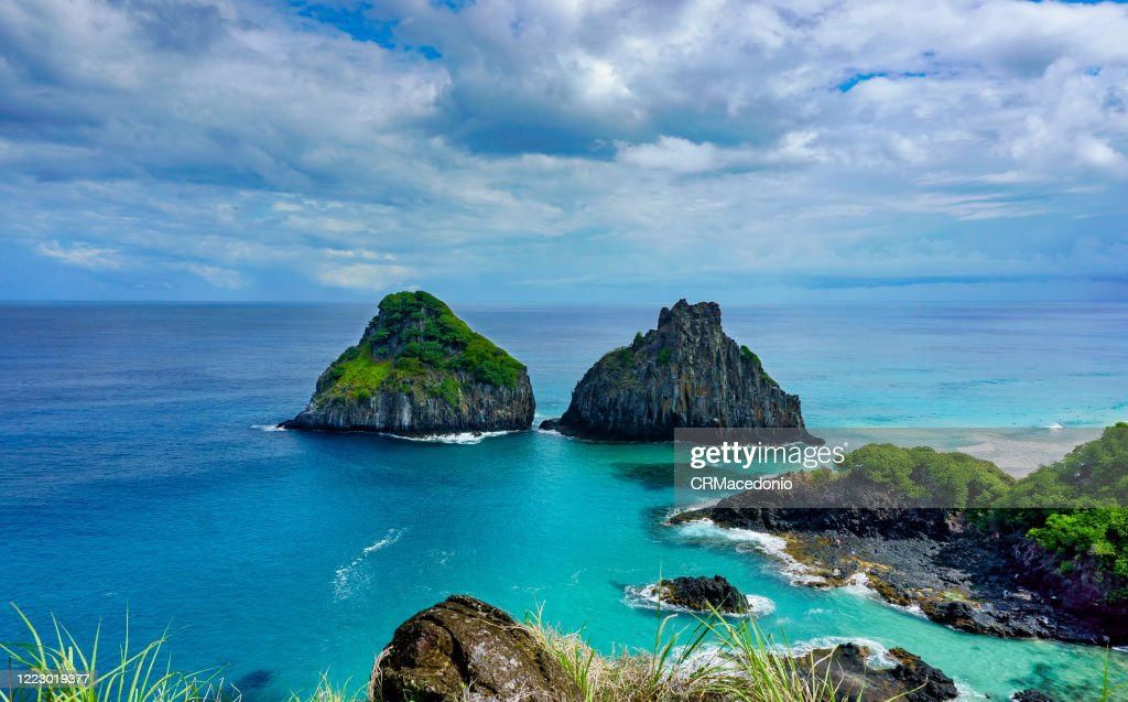 Two Brothers rock formation at Baía dos Porcos beach, Fernando de Noronha. : Stock Photo