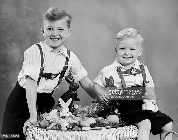 Two brothers sit with Easter decorations ca 1948