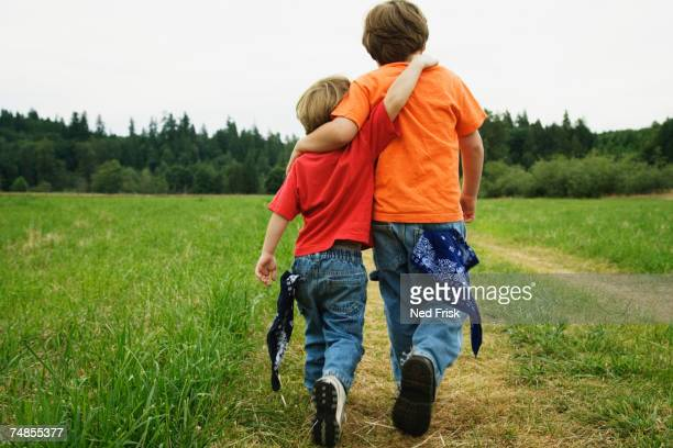 Two brothers walking in field