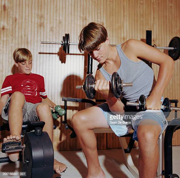 Two brothers (12-15) working out in home gym