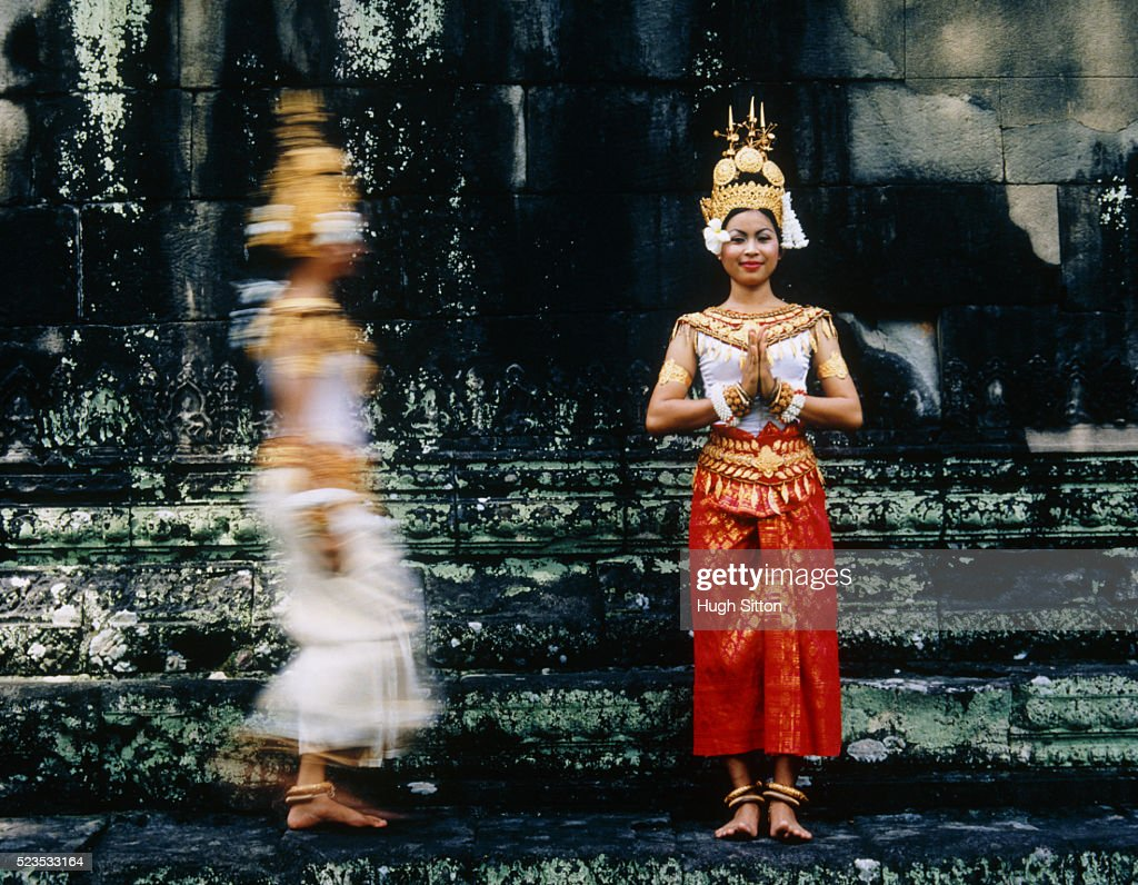 Two Buddhist Dancers on Temple Steps : Stock Photo