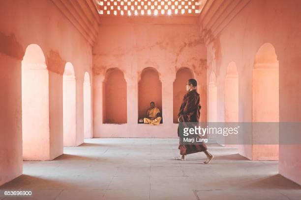 Two Buddhist monks at the Mahabodhi Mahavihara temple in Bodhgaya Bihar India