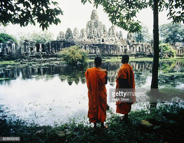 Two Buddhist Monks by Lake Opposite Temple