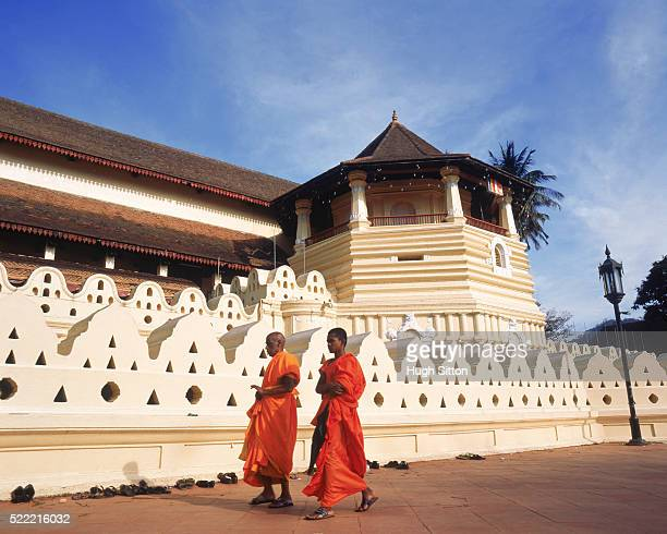 two buddhist monks in front of temple, sri lanka - hugh sitton stock pictures, royalty-free photos & images