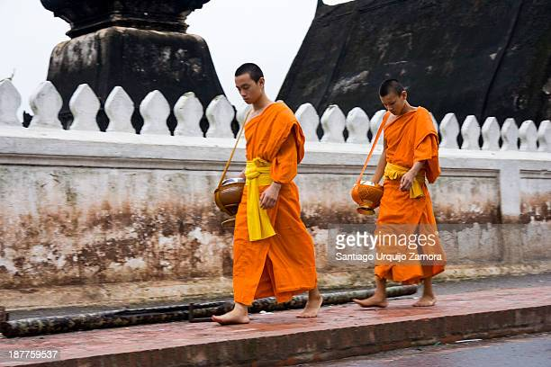 CONTENT] Two Buddhist monks in saffron robes in their morning food collection at Luang PPraba Prabang Laos Every morning at sunrise people line the...