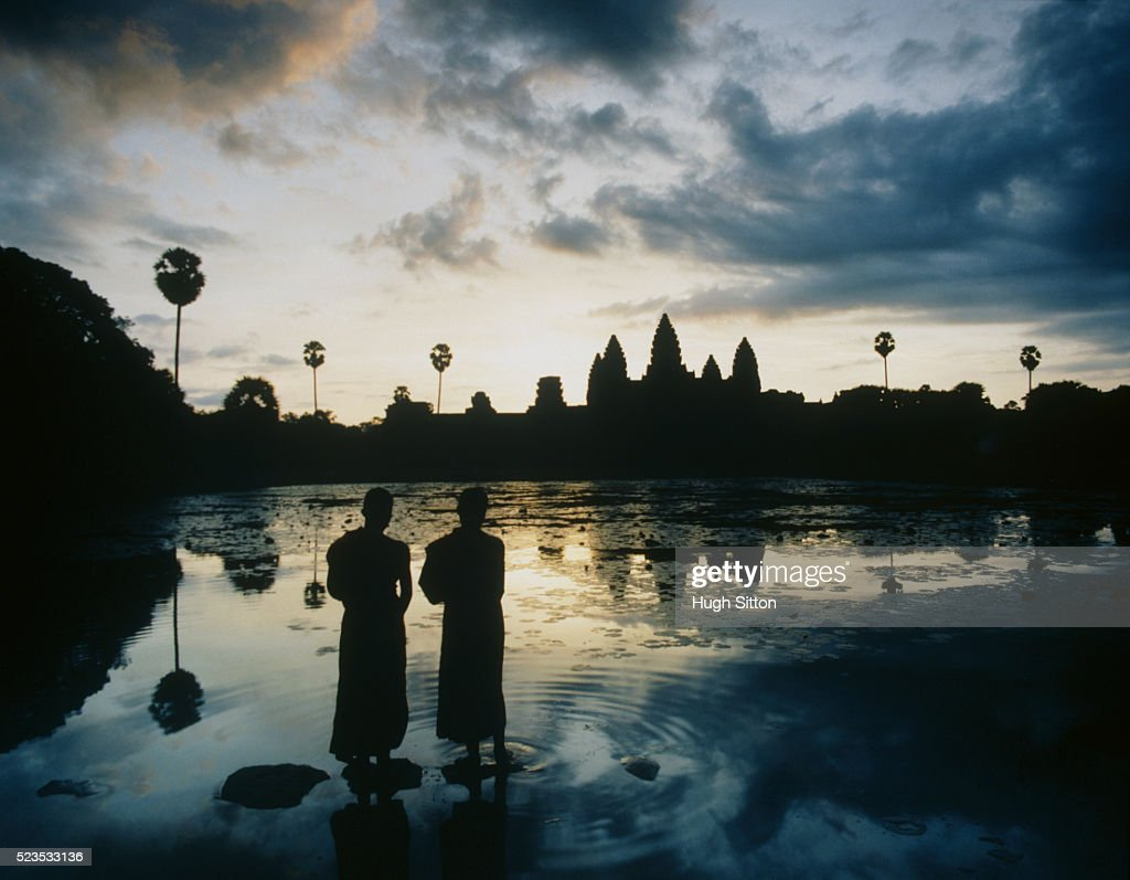 Two Buddhist Monks on Rocks at Dawn : Stock Photo