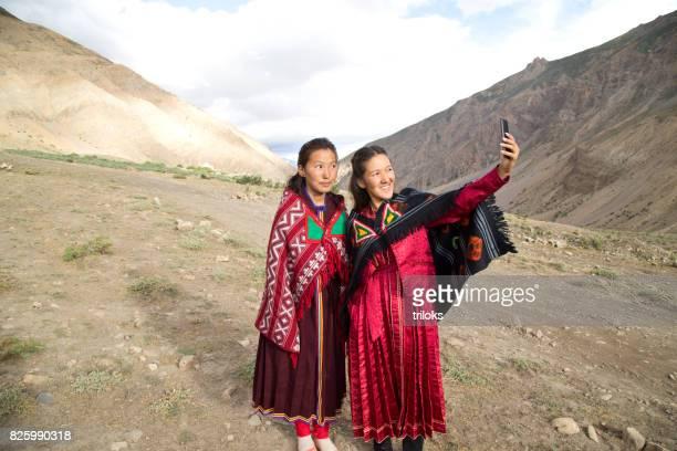 Two Buddhist women taking a selfie