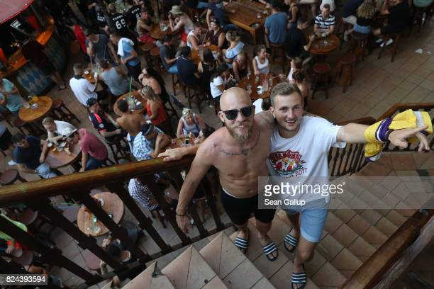 Two buddies pose for a photo while partying at the Bierkoenig beer hall near the Ballermann stretch on July 27 2017 in Palma de Mallorca Spain The...