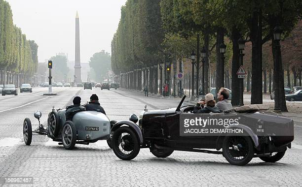 Two Bugatti first generation drive on the ChampsElysees Avenue on September 20 2009 in Paris at the end of a Bugatti rallye which started in Mulhouse...