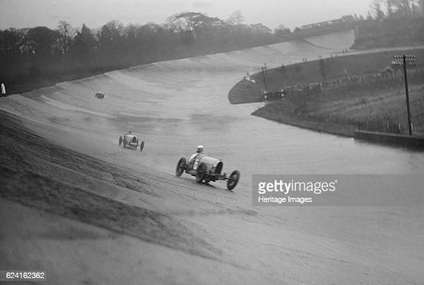 Two Bugattis racing at a BARC meeting Brooklands Surrey 1931 Artist Bill BrunellCentre Bugatti Type 37 1496 cc Event Entry No 6 Background Bugatti...