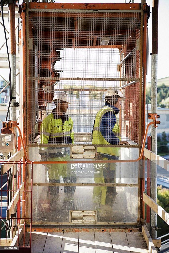 Two building worker at a building site Sweden. : Stock Photo