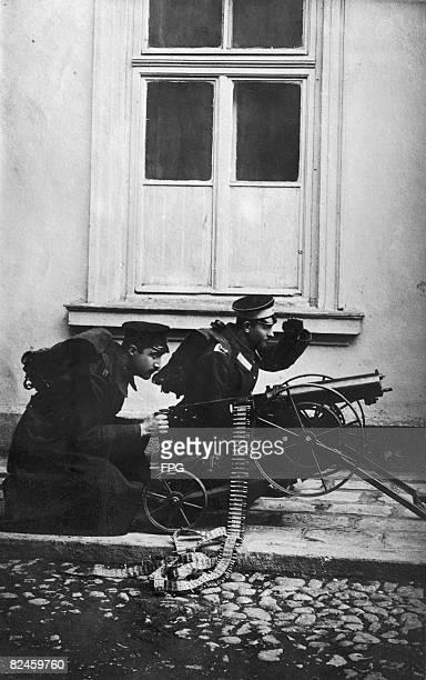 Two Bulgarian soldiers operate a machine gun during the Balkan crisis of World War I circa 1915
