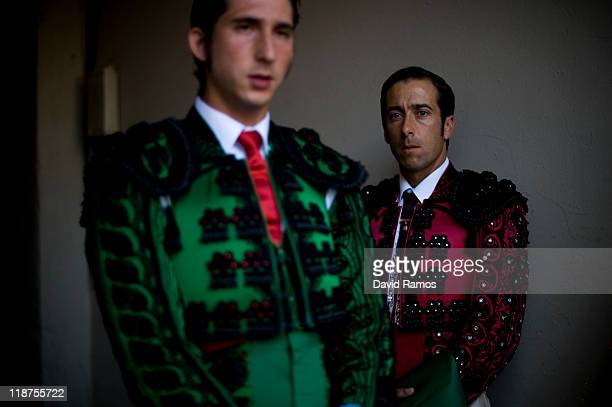 Two bullfighters look on before the second bullfight of the 2011 season at the Monumental bullring on July 10 2011 in Barcelona Spain This will be...