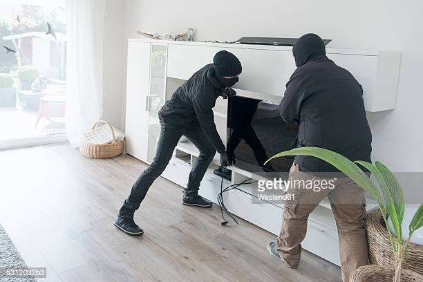 two burglars at work in an one-family house at daytime - thief stock pictures, royalty-free photos & images