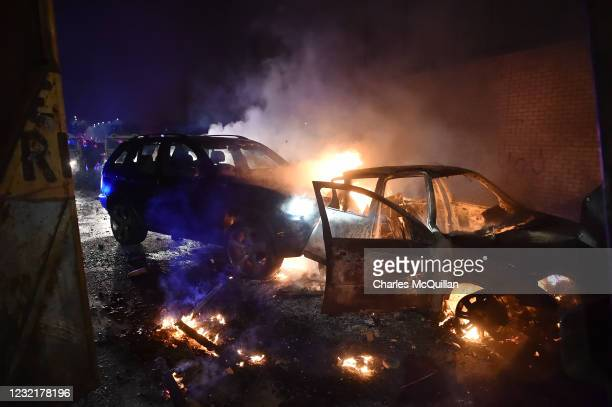 Two burnt out cars hijacked by loyalists are seen after they were rammed in to the Peace Wall gates that seperate the two communities on April 7,...
