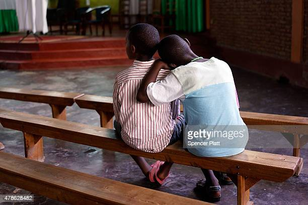 Two Burundian children pause during a memorial service at a Catholic church for those killed in recent violence as the country becomes increasinglty...