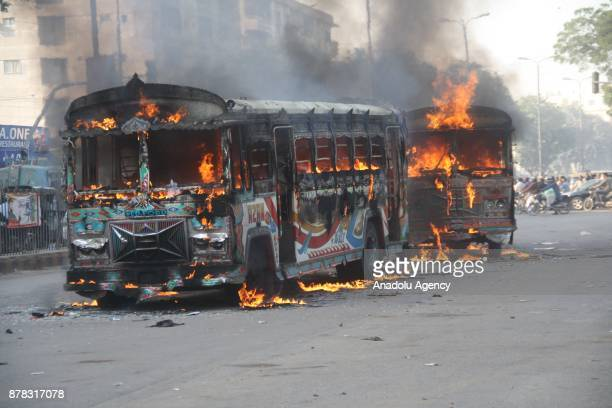 Two buses are seen on fire in Karachi Pakistan on November 24 2017 A mob set 2 buses on fire after one of them hit a motorcycle and killed a...