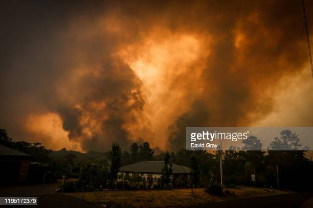 Two bushfires approach a home located on the outskirts of the town of Bargo on December 21 2019 in Sydney Australia A catastrophic fire danger...