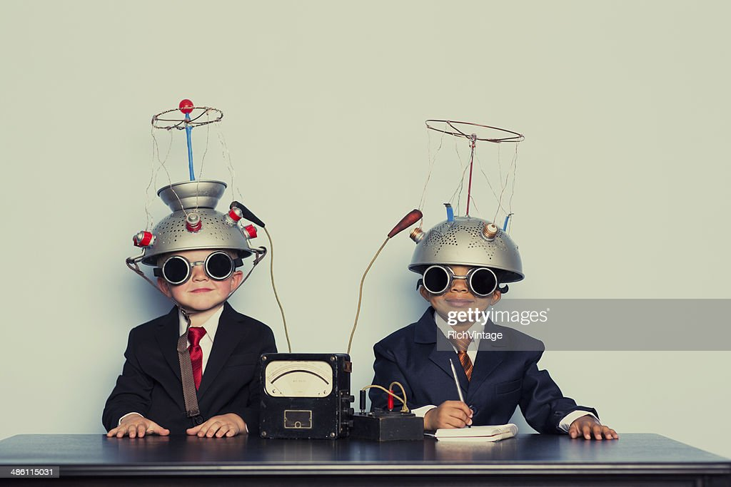 Two Business Boys with Mind Reading Helmets : Stock Photo