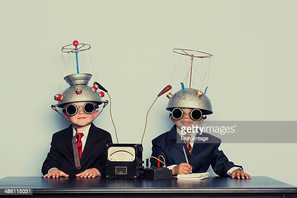 Two Business Boys with Mind Reading Helmets