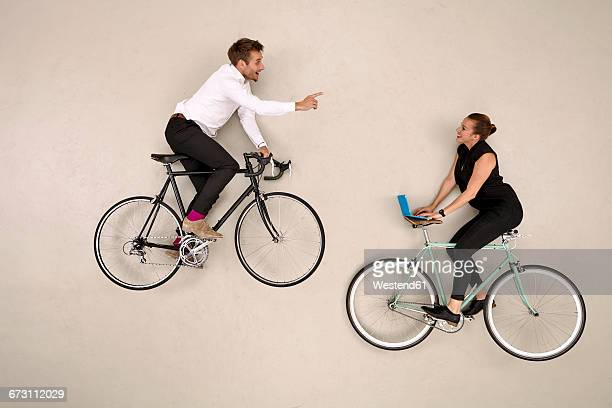 Two business colleagues biking and communicating