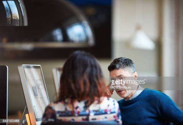 two business colleagues discussing a project - candid stock pictures, royalty-free photos & images