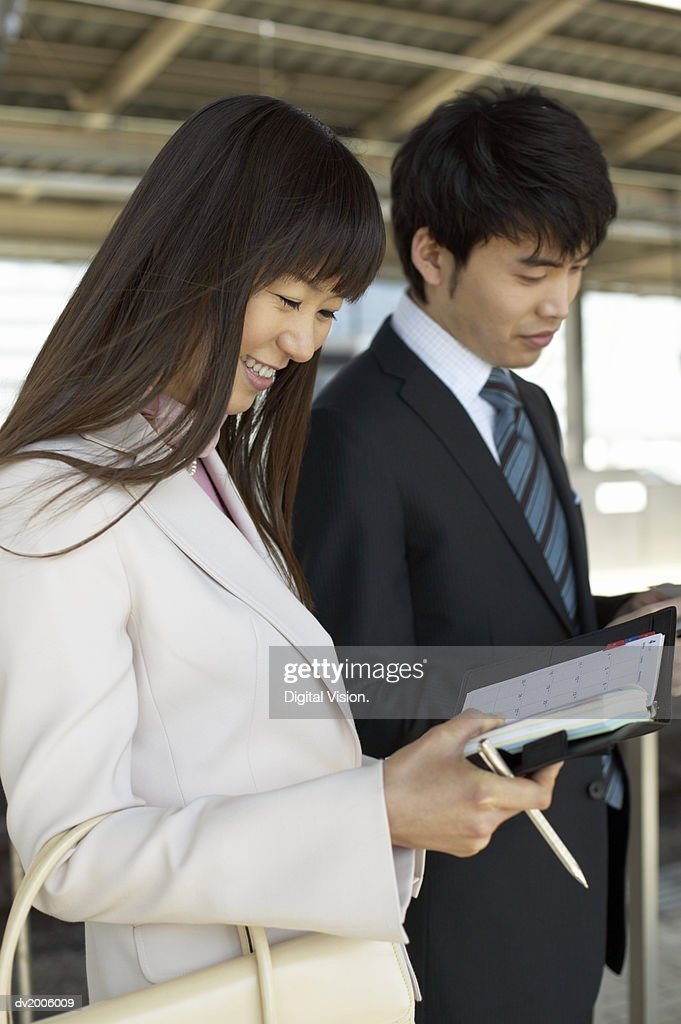 Two Business Colleagues Looking at Their Diaries : Stock Photo
