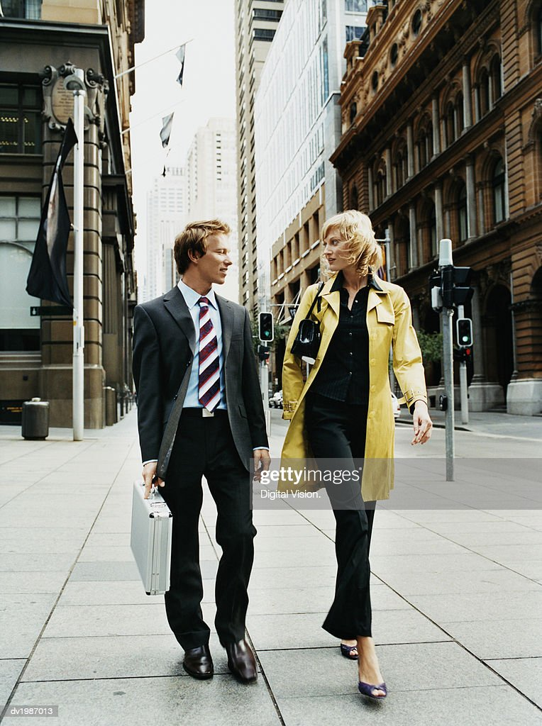 Two Business Colleagues Walking on a Pavement in the City : Stock Photo