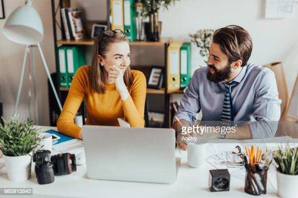 two business colleagues working together in the office - editorial stock pictures, royalty-free photos & images