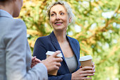 cheerful beautiful businesswomen with coffee cup