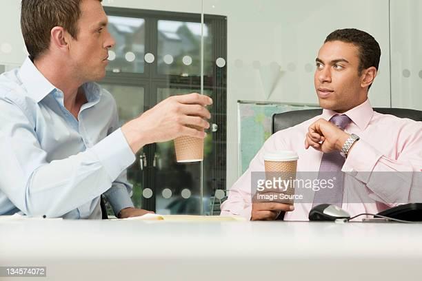 Two business men having an informal meeting
