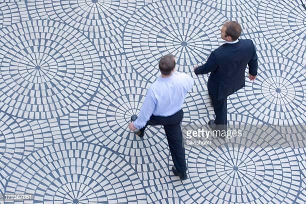 Two business men talk