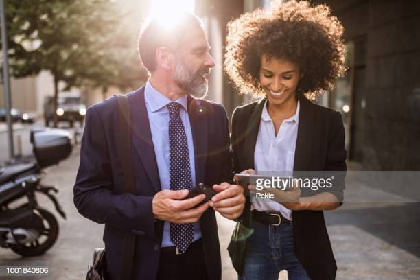Two business people chatting after work