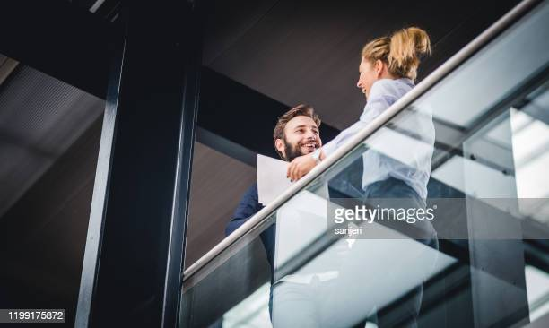 two business people discussing on the hallway - capital cities stock pictures, royalty-free photos & images