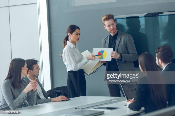 two business people giving a presentation - financial analyst stock photos and pictures