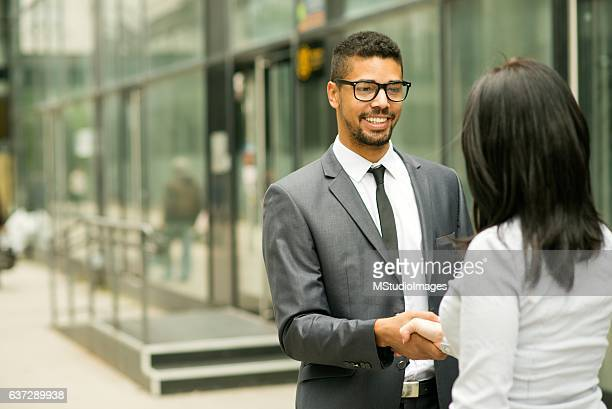Two business people having a handshake