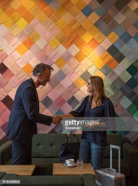 two business people having meeting in a cafe - multi coloured purse stock photos and pictures