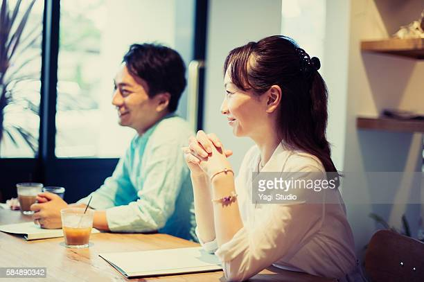 Two business people meeting in a cafe