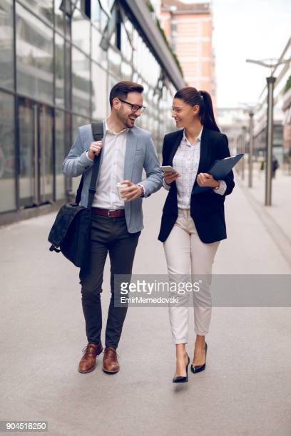 Two business people on their way to work