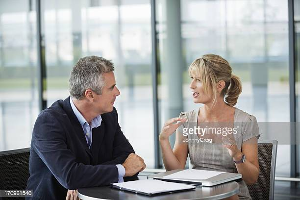 two business people sitting, having a conversation - formal stock pictures, royalty-free photos & images