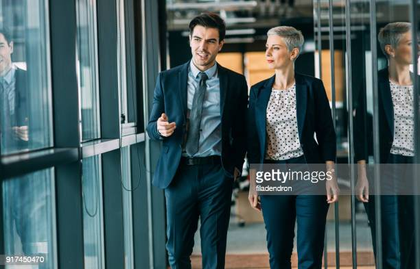 Two business people taking