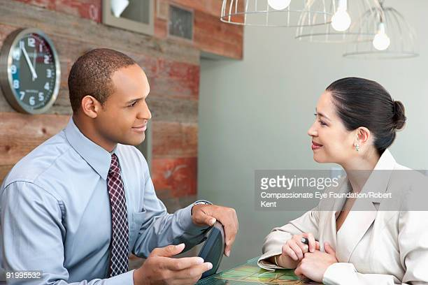"two business people talking  - ""compassionate eye"" ストックフォトと画像"