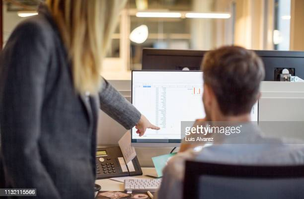 two business people working together on computer - long hair stock pictures, royalty-free photos & images