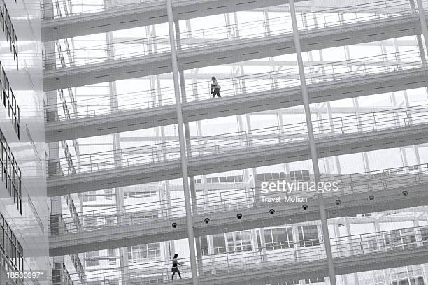 Two business woman walking on elevated walkway