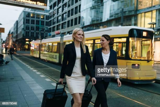 Two Business Women Walking Through The City