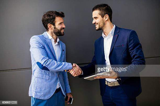 Two businessman discussing