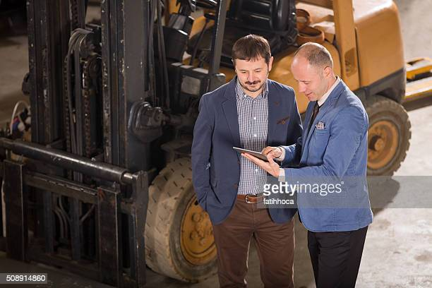 Two Businessman in Factory